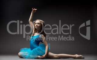Lovely little ballerina inspired dancing in studio