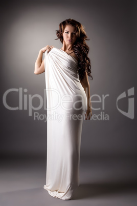Beautiful brunette posing as statue. Studio photo