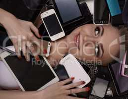 Top view of satisfied girl with many smartphones