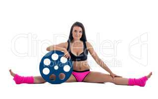 Pretty athletic woman posing with barbell's disk