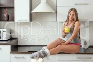 Model in comfortable underwear posing on kitchen