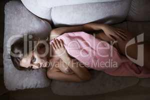 Resting nude woman posing hiding behind towel