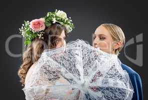 Lesbian wedding. Bride and groom admire each other