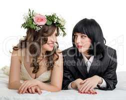 Studio photo of girls dressed as bride and groom