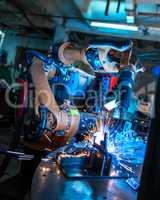 Manufacturing. Robotic machine welding metal