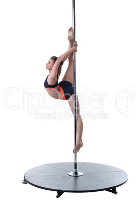 Strength and grace of pole dance. Cute girl posing