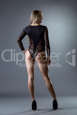 Model posing in erotic bodysuit black color