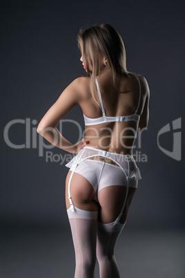 Back view of model in lingerie and garter belt