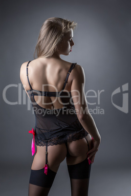 Advertising lingerie. Back view of seductive model
