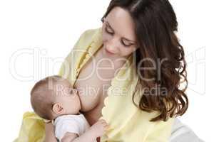 Studio photo of woman breastfeeding her baby