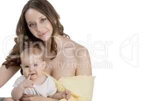 Studio portrait of pretty woman and her baby