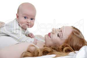 Toddler posing while lying on mother's breast