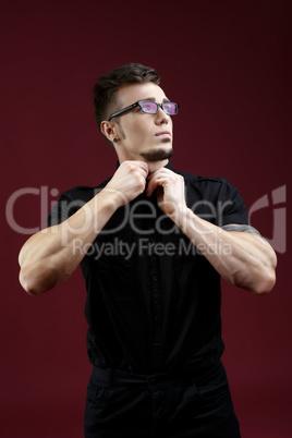 Advertising stylish glasses. Handsome man posing