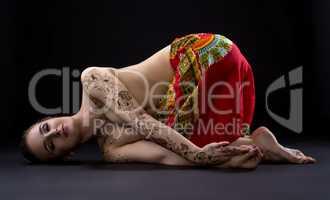 Yoga. Photo of beautiful woman with mehndi