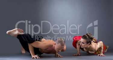 Yoga. Beautiful couple doing difficult asana