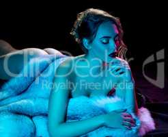 Erotica. Nude beauty posing with luxurious fur