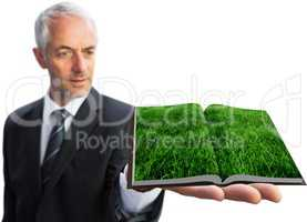 Man showing lawn book