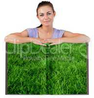 Woman with lawn book