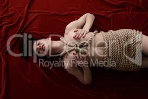 Bondage as sexual fetish. Woman tied with rope