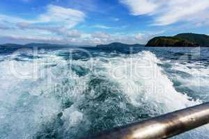 Seascape while boating. Image of sea foam on waves