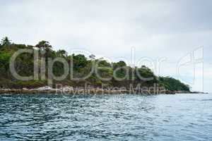 Seascape while boating. View of island coast
