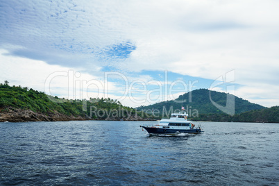 Seascape - boat on background of tropical island