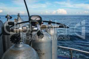 Diving equipment. Gas cylinders on sea backdrop