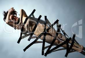 Sexual bondage. Nude woman with black duct tape