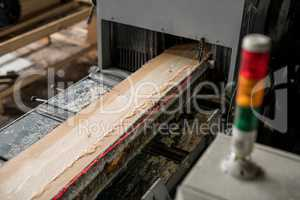At sawmill. Image of sawing wood with laser marks