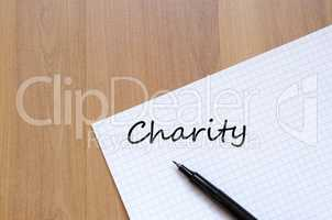 Charity write on notebook
