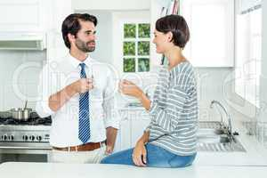 Woman interacting with businessman during coffee break