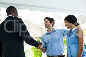 Real estate agent giving house keys to the couple