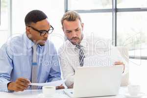 Businessmen discussing a report