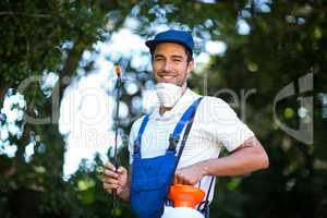 Portrait of happy insecticide worker