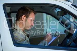 Delivery man sitting in his van
