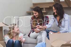 Friends interacting with each other in their new house
