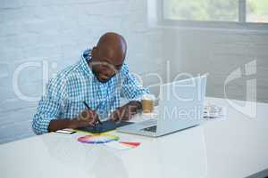 Graphic designer working on his graphics tablet