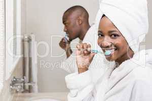 Young couple brushing teeth