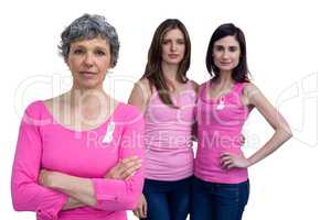 Women in pink outfits posing for breast cancer awareness