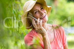 Senior woman using phone in yard