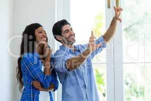 Couple framing a picture with hands