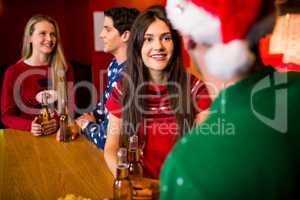 Smiling friends with christmas accessory
