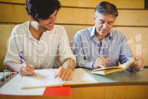 Professor assisting a student with his study