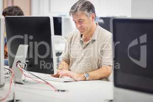 Professor working on computer