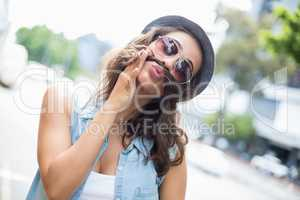 Young woman pulling funny faces