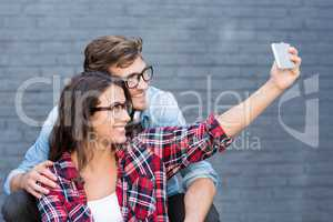 Young couple in spectacles taking a selfie