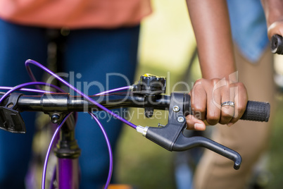 focus on hands and bicycle