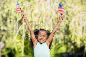 Young girl showing usa flag