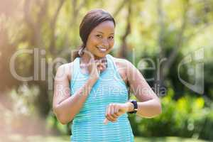 Happy woman looking her watch