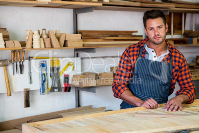Carpenter posing with his craft